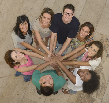 Teamwork: Group of diverse people joining hands